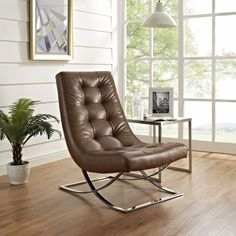 The Slope lounge chair and ottoman set was designed to serve as a carefree and comfort-filled way to spend your leisure time. The Slope lounge chair and ottoman series is perfect for modern living rooms and lounge spaces.