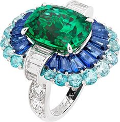 Van Cleef & Arpels Adria ring: White gold, platinum, round and baguette-cut diamonds, baguette-cut sapphires, Paraíba-like tourmalines, one cushion-cut emerald of 8.35 carats (Zambia). © Van Cleef & Arpels