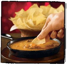 Addicted to this, hoping it tastes the same!!! Chili's Skillet Queso  16-ounce box Velveeta Cheese *1 C. milk  2 teaspoons paprika *½ tsp. ground cayenne pepper  15-ounce can Hormel Chili (No Beans) * 4 tsp. chili powder  1 tablespoon lime juice *½ tsp. ground cumin.