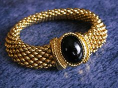 Chunky Gold Tone Mesh Bracelet with Black Oval Cabochon Detail by dazzledbyvintage on Etsy