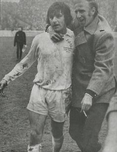 7th April 1973. Jack Charlton, who had hobbled off with an hamstring injury, congratulates Peter Lorimer following Leeds 1-0 victory against Wolves, in the FA Cup Semi Final, at Maine Road. Football Boots, Football Team, The Damned United, Jack Charlton, Leeds United Fc, Football Images, Vintage Football, Semi Final, Fa Cup