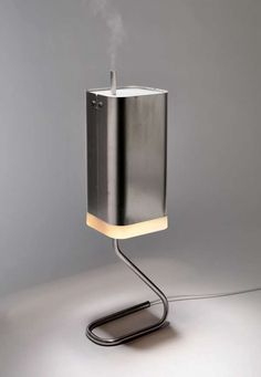 The Host Lamp is designed to accommodate a fully integrated passenger appliance, a small humidifier. The principle of the host lamp is very simple – wasted heat energy Id Design, Lamp Design, Lighting Design, Small Humidifier, Clever Gadgets, Cool Electronics, Yanko Design, Aroma Diffuser, How To Make Light