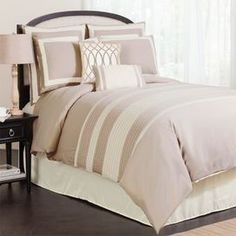 """Comforter set in beige with embroidered and pin-tucked details.   Product: Queen: 1 Comforter, 1 bed skirt, 2 Euro shams, 2 standard shams and 2 decorative pillowsKing: 1 Comforter, 1 bed skirt, 2 Euro shams, 2 king shams and 2 decorative pillowsCalifornia King: 1 Comforter, 1 bed skirt, 2 Euro shams, 2 king shams and 2 decorative pillows Construction Material: PolyesterColor: BeigeFeatures:   Embroidered and pin-tucked detailsSquare and lumbar decorative pillows include inserts14.5"""" Bed…"""