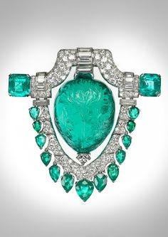 Marjorie Merriweather Post's platinum brooch from the 20s featuring a spectacular 60ct carved Mughal emerald surrounded by diamonds