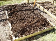 Notice the lighter brown pile, that is the dry peat moss. In a 4 x 6 plot you want to put in about 1/2 a bag of peat moss in to start. I have clay soil. If your soil is in better shape... use less. Worse shape... use more.