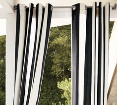 """Sunbrella® Awning Stripe Outdoor Drape, 50 x 84""""    suddenly obsessed with black and white stripes for outdoors..."""