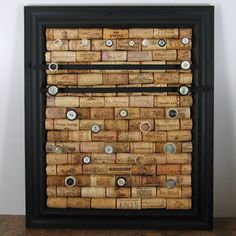 just one piece in my picture frame jewelry organizer display diy  .... love the wine corks! Im thinking ring organizer.