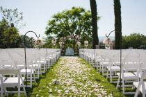 Wedding aisle will have six floral aisle posies in wedding flowers hanging from americana chairs