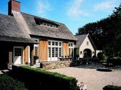 love Ina Garten's Belgian barn... especially the large sliding shutters