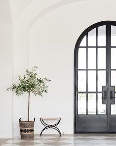 Big arched doors and checkered marble floors. 🙌🏼 Currently headed to Atlanta market and I can't wait to be overloaded with inspiration! This is one of my favorite pics from our project! You can shop the decor 📷: Interior Modern, Home Interior, Interior And Exterior, Interior Decorating, Black Trim Interior, Scandinavian Interior Doors, Interior Design Brief, Beautiful Interior Design, Home Design