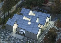 Unsangdong Architects has designed the Hannae Forest of Wisdom community centre in Seoul with a row of intersecting gabled forms enclosed by glass end walls. Chinese Architecture, Contemporary Architecture, Landscape Architecture, Roofing Felt, Community Space, Gable Roof, Site Plans, The Gables, Outdoor Furniture Sets