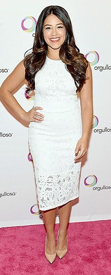 The Jane the Virgin actress charmed in a little white dress with a lace hem. She added pops of color via camel-colored shoes and a red statement lip.