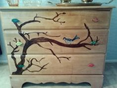 An old chest sanded, drawed a tree with pencil, taped it off, stained with dark stain. Drawed bird, then colored with permenate markers, then applied 3 coats of clear stain. I wanted leaf knobs, but they were 28.20 on line. I got polymer clay. Shaped, baked, painted, baked again. Put screw in and take back out before baking the first time, when dry    Its perfect.