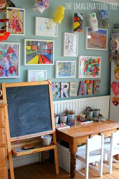 How to create a child's creative space-I really love the colorful wall of art displayed in the space. wall colors, art spaces, kid spaces, kid art, playroom, creativ space, artwork, craft rooms, art rooms