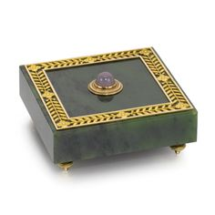 A Fabergé gold-mounted nephrite bellpush, workmaster Henrik Wigström, St Petersburg, 1908-1917, square, centred with a pink quartz cabochon pushpiece, the openwork border chased with gold quatrefoils within leaf trails, toupee feet.