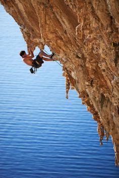 Rock climbing overlooking the Aegean sea