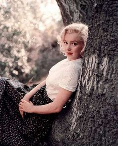 Marilyn. Tree sitting, Laurel Canyon. Photo by Milton Greene, 1953.