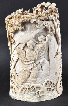 A FINE 19TH CENTURY JAPANESE MEIJI PERIOD IVORY TUSK VASE AND COVER depicting figures battling a dragon within a landscape. Signed. 7.5ins high.