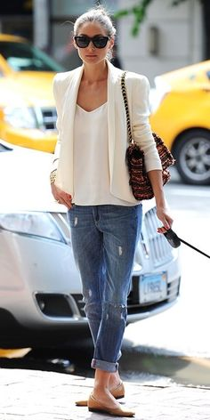 White blazers contrast with worn in boyfriend jeans.