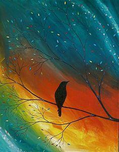 Bird silhouette against rainbow sky