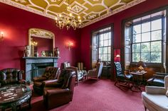 The Dalwolsey Room is richly painted in regal red, with antique leather furniture and an ornate fireplace. Function Room, Edinburgh Scotland, Leather Furniture, Conference, Castle, Events, Interiors, Antiques, Red