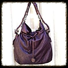 Monserat De Lucca hobo bag REDUCED! Looking for a fabulous bag? This is Monserat De Lucca's Don Fidel Hobo – a beautiful bag that's deep and roomy. It has that biker chick chic look that Monserat De Lucca is known for.  It has super soft pebbled dark brown leather and a fabulous braided leather shoulder strap that goes from side to side. It has a removable shorter strap just beneath. A great bag for work or play. Show off your edgy side with this fabulous bag.  With original tags and dust…
