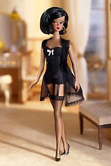 2002 Lingerie Barbie® Doll #5 Robert Best / The Barbie® Fashion Model Collection unveils its first-ever African-American Silkstone™ doll, the fifth Lingerie Barbie® doll. Her enchanting ensemble begins with a delicate black merry widow bustier with pink bow accent. Her matching robe offers alluring cover. Golden hoop earrings and high heels complete this simple but elegant ensemble, perfect for dress-and-play fun! www.modbarbies.com