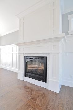 Craftsman fireplace mantel with board and batten wainscoting. Craftsman fireplace mantel with board Craftsman Fireplace Mantels, Home Fireplace, Fireplace Remodel, Fireplace Surrounds, Fireplace Design, Fireplace Ideas, Fireplace Moulding, Fireplace Built Ins, Herringbone Fireplace