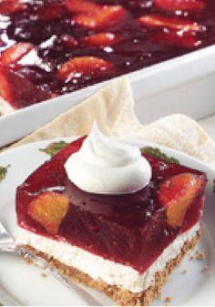 Orange-Cranberry Dream — Fruity cranberry gelatin meets mandarin oranges and fluffy cream cheese in this impressive layered dessert.