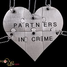 Stainless Steel Partners in Crime 6-Piece Necklace Set: Made of lasercut stainless steel with a silver color, the heart is 3 inches at the widest point when assembled. It breaks into 6 puzzle piece pendants, each with its own matching 24 inch long silver plated necklace chain. Limited quantities available. Also sold in a brass version.