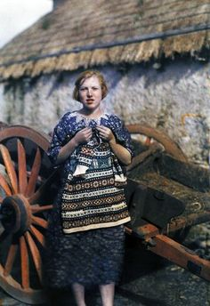 Ireland, 1920s - a young girl knits a wool garment. Photograph by Clifton R. Adams