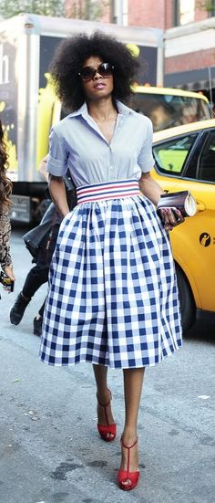 Tuck in a button-down into a gingham skirt