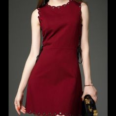"""Coming Soon Stylish Mini Dress This is a beautiful dress in such a rich red color. It is adorned with metal detailing that make such a statement to the dress.      :        Shoulder: 13.8"""".                                                          Bust: 34.6"""".                                                                 Waist: 29.1"""".                                                               Length: 35.4"""".                                                           Fabric: 95% cotton/5%…"""