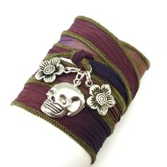 This silk wrap bracelet features a Mexican Day of the Dead skull with two flowers. Want a different ribbon or charms, contact me! The skull symbolizes death and rebirth in the Mexican holiday, a reminder of those who have gone before us. All of the silk ribbons I use are hand painted and simply stunning. I don't think the photos do them justice. Both the color and the texture are amazing. This one is a mix of plum, purple, and blue.