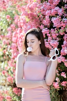 I have been waiting to do this look for the longest time! I don't know why, but the thoughts of a little pink dress and bubblegum had me on cloud 9 #fashion #womensfashion #pink #photoshoot #photography #springfashion #summer #summerfashion #blog #blogger