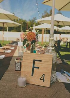 Wooden scrabble letter table numbers  | photo by Rock the Image | 100 Layer Cake