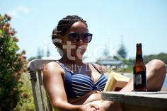 Woman relaxes with a Book and a Beer, Summer, NZ royalty-free stock photo