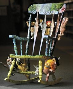 A rocking chair with decorations inspired by the book, Where the Wild Things Are.