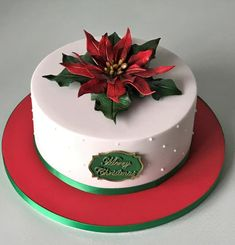 Rich fruit Christmas Cake made for my Brother & sister in law with handmade poinsettia. Fondant Christmas Cake, Christmas Tree Cake, Christmas Cake Decorations, Christmas Cupcakes, Holiday Cakes, Christmas Desserts, Christmas Baking, Christmas Cake Designs, Easy Christmas Treats