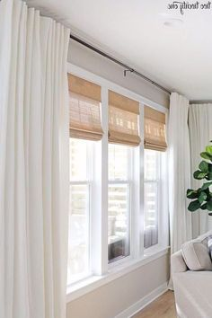 Home Interior Livingroom Budget-friendly cordless woven shades and linen cotton curtains, paired with black curtain rods. Classic look for a living room on a budget! Black Curtain Rods, Black Curtains, Curtains With Blinds, Modern Curtains, Kitchen Curtains, Living Room Blinds And Curtains, Livingroom Curtain Ideas, Curtains For Bedroom, Window Curtains