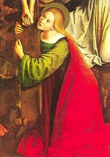Saint Mary Magdalene at the foot of the Cross of Christ.