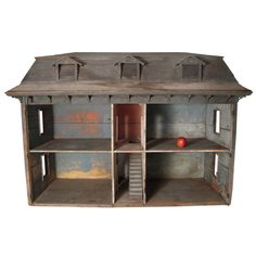 I had a doll house that my big brother, Gene, built for me.  It looked a little like this one, only it was white and it had a hinged roof.  I loved that dollhouse!