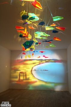 "Wow, that is friggin' amazing! The ""painting"" is made by the light through the glass"