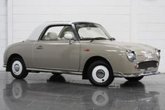 little cars... a Nissan Figaro