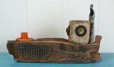 Driftwood Boats Handmade boats and beach art made from reclaimed materials by coastal artist Clare Willison in West Sussex.
