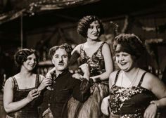 "Charlie Chaplin, set of ""The Gold Rush"".  Actress Joan Lowell, Georgia Hale and Kay Deslys.  source: chaplin-images-videos.tumblr.com"