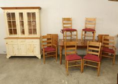 """Ethan Allen dining set incl two part step back hutch having glass shelves, interior lighting, two glass doors over three doors, three dovetail construction drawers, 65"""" x 19"""" x 82""""T, expandable table with single drawer having dovetail construction 68"""" x 40"""" x 30.5""""T with two 20"""" leaves, two arm chairs and four side chairs all having cushions."""