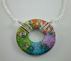I like the colors in these and the fact that they are made from washers! How fun!