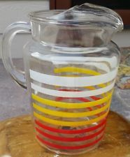 Vintage retro lipped glass pitcher with white, yellow, red stripes