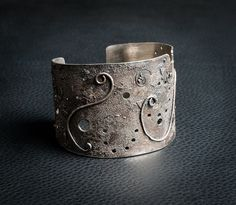 Solid silver, hallmarked bangle by Christine East from the Present Maker exhibition at Harbour House, December 2015. The collection features a wide range of art and craft by nine members of the South Hams Arts Forum.
